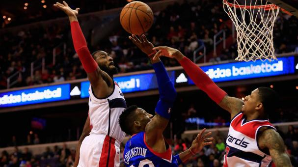 Robert Covington #33 of the Philadelphia 76ers puts up a shot in front of John Wall #2 and Bradley Beal #3 of the Washington Wizards at Verizon Center on January 19, 2015 in Washington, DC. Getty Images