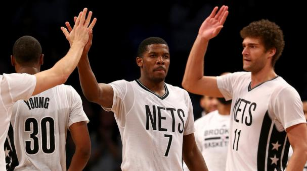 Joe Johnson #7 and Brook Lopez #11 of the Brooklyn Nets celebrate against the Milwaukee Bucks at the Barclays Center on March 20, 2015 in the Brooklyn borough of New York City. Getty Images