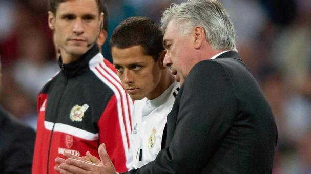Carlo Ancelotti (R) of Real Madrid CF gives instructions to his player Javier Hernandez Chicharito (L) during the La Liga match between Real Madrid CF and Elche CF at Estadio Santiago Bernabeu on September 23, 2014 in Madrid, Spain. Getty Images
