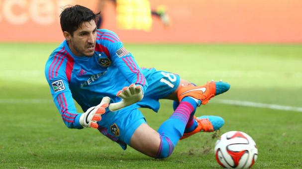 Goalkeeper Jaime Penedo #18 of the Los Angeles Galaxy makes a save in the second half of regulation time during 2014 MLS Cup at StubHub Center on December 7, 2014 in Los Angeles, California. (Getty Images)