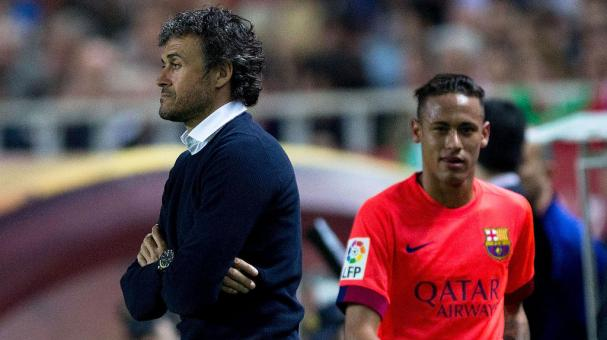 Head coach Luis Enrique Martinez (L) of FC Barcelona looks on as his player Neymar JR. (R) is relevated during the La Liga match between Sevilla FC and FC Barcelona at Estadio Ramon Sanchez Pizjuan on April 11, 2015 in Seville, Spain. (Getty Images)