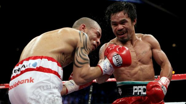 Manny Pacquiao throws a right to the body of Miguel Cotto during their WBO welterweight title fight at the MGM Grand Garden Arena on November 14, 2009 in Las Vegas, Nevada. (Photo by Al Bello/Getty Images)