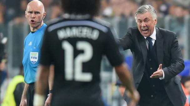 Carlo Ancelotti head coach of Real Madrid CF gives instructions to Marcelo of Real Madrid CF, match Juventus and Real Madrid CF at Juventus Arena on May 5, 2015 in Turin, Italy. (Photo by Michael Regan/Getty Images)