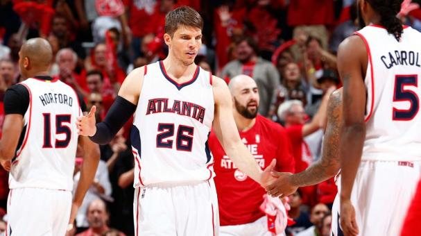 Kyle Korver #26 of the Atlanta Hawks reacts with Jeff Teague #0 and DeMarre Carroll #5 during a timeout against the Washington Wizards at Philips Arena on May 5, 2015 in Atlanta, Georgia. Getty Images