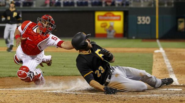 Catcher Carlos Ruiz #51 of the Philadelphia Phillies tags out Steve Lombardozzi #23 of the Pittsburgh Pirates at Citizens Bank Park on May 13, 2015 in Philadelphia, Pennsylvania. (Photo by Rich Schultz/Getty Images)