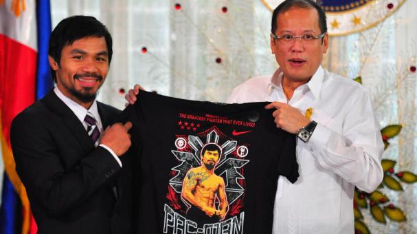 Manny Pacquiao gives President Benigno Aquino III a shirt and memorabilia following his win of the WBC super welterweight crown against Antonio Margarito on November 20, 2010 in Manila, Philippines. Getty Images