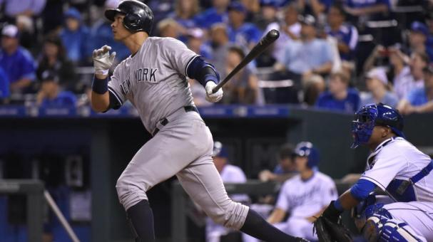 Alex Rodriguez #13 of the New York Yankees hits a home run in the ninth inning against the Kansas City Royals at Kauffman Stadium on May 16, 2014 in Kansas City, Missouri. (Getty Images)