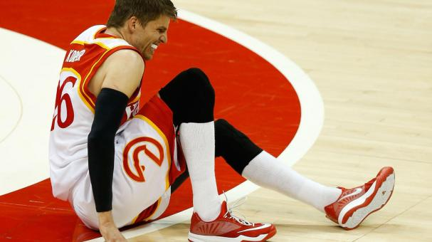 Guard Kyle Korver #26 of the Atlanta Hawks falls to the court after injured his leg against the Cleveland Cavaliers during the 2015 NBA Playoffs at Philips Arena on May 22, 2015 in Atlanta, Georgia. Getty Images