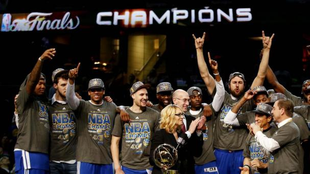 Golden State Warriors celebrates NBA Championship Trophy after winning Game Six of the 2015 NBA Finals against the Cleveland Cavaliers at Quicken Loans Arena on June 16, 2015 in Cleveland, Ohio. Getty Images