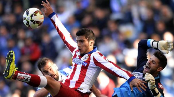 Atletico Madrid's Raul Jimenez (C) jumps for the ball during the Spanish league football match RC Deportivo La Coruna v Club Atletico de Madrid at the Municipal de Riazor stadium in La Coruna on April 18, 2015. (MIGUEL RIOPA/AFP/Getty Images)