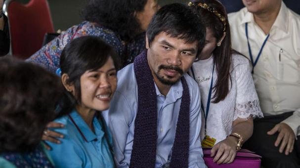 Manny Pacquiao and his wife Jinkee, meet convicted drug trafficker Mary Jane Veloso of the Philippines during a visit at Wirogunan prison on July 10, 2015 in Yogyakarta, Indonesia. Getty Images