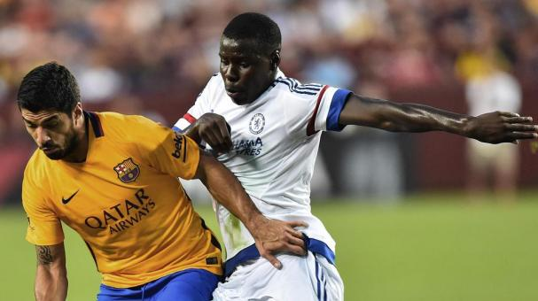 Barcelona's Luis Suarez (L) vies with Chelsea's Kurt Zouma during an International Champions Cup football match in Landover, Maryland, on July 28, 2015. (NICHOLAS KAMM/AFP/Getty Images)