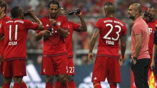 Team coach Josep Guardiola (R) of Bayern Muenchen talks to Arturo Vidal (2ndR) during the Audi Cup final match between FC Bayern Muenchen and Real Madrid at Allianz Arena on August 5, 2015 in Munich, Germany. (Getty Images)