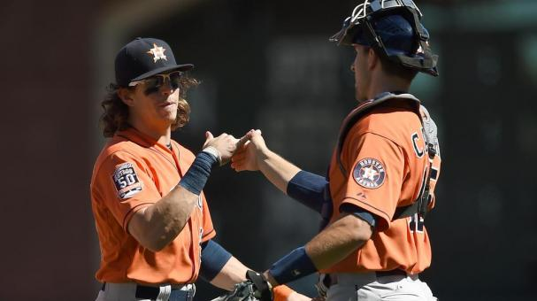 Colby Rasmus #28 and Jason Castro #15 of the Houston Astros celebrates defeating the San Francisco Giants 2-0 at AT&T Park on August 12, 2015 in San Francisco, California. (Photo by Thearon W. Henderson/Getty Images)