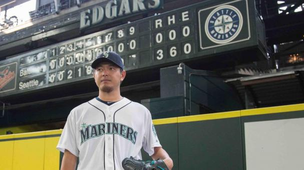Starting pitcher Hisashi Iwakuma #18 of the Seattle Mariners poses in front of the scoreboard after throwing a no-hitter to defeat the Baltimore Orioles 3-0 at Safeco Field on August 12, 2015 in Seattle, Washington. (Getty Images)