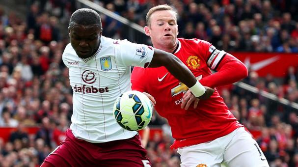 Wayne Rooney of Manchester United and Jores Okore of Aston Villa during the Premier League match between Manchester United and Aston Villa at Old Trafford on April 4, 2015 in Manchester, England. (Getty Images)