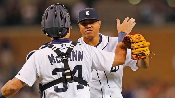 Alfredo Simon #31 and James McCann #34 of the Detroit Tigers celebrate a win over the Texas Rangers on August 20, 2015 at Comerica Park in Detroit, Michigan. The Tigers defeated the Rangers 4-0. (Getty Images)