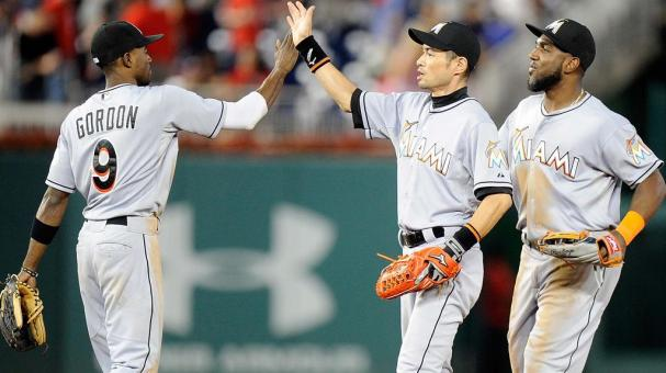 Ichiro Suzuki #51 of the Miami Marlins celebrates with Dee Gordon #9 after a 4-3 victory against the Washington Nationals at Nationals Park on August 28, 2015 in Washington, DC. (Getty Images)