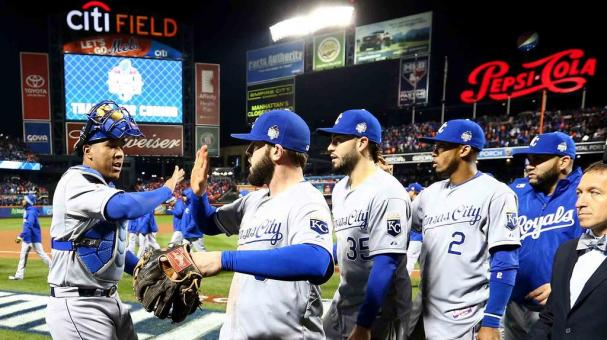 Salvador Perez #13, Mike Moustakas #8, Eric Hosmer #35 and Alcides Escobar #2 of the Kansas City Royals celebrate defeating the New York Mets in Game 4 of the 2015 World Series at Citi Field on Saturday, October 31, 2015. (Getty Images)