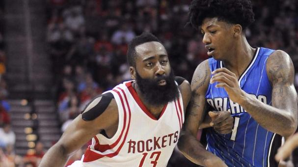 Houston Rockets' James Harden (13) drives the ball past Orlando Magic's Elfrid Payton during the second half of an NBA basketball game Wednesday, Nov. 4, 2015, in Houston. The Rockets won in overtime, 119-114. (AP Photo/Pat Sullivan)