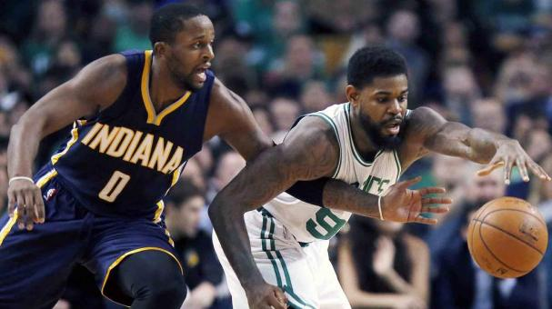 Indiana Pacers' C.J. Miles (0) and Boston Celtics' Amir Johnson (90) reach for a loose ball during the first quarter of an NBA basketball game in Boston, Wednesday, Nov. 11, 2015. (AP Photo/Michael Dwyer)