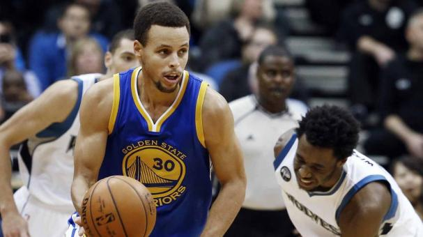 Golden State Warriors' Stephen Curry, left, beats Minnesota Timberwolves' Andrew Wiggins to the ball during the second half of an NBA basketball game, Thursday, Nov. 12, 2015, in Minneapolis. The Warriors won 129-116. (AP Photo)