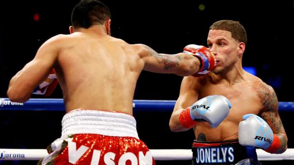 Jesus Cuellar (L) of Argentina punches Jonathan Oquendo of Puerto Rico during their WBA Featherweight Championship bout on December 5, 2015 in the Brooklyn borough of New York City. (Getty Images)