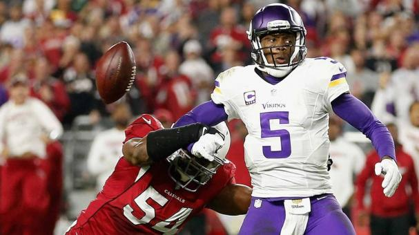 QB Teddy Bridgewater #5 of Minnesota Vikings has the ball knocked free by linebacker Dwight Freeney #54 of Arizona Cardinals during the final moments of NFL game at the University of Phoenix Stadium on December 10, 2015 in Glendale, Arizona. Getty Images