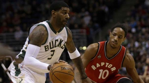 O.J. Mayo #3 of the Milwaukee Bucks drives to the hoop during the first quarter against the Toronto Raptors at BMO Harris Bradley Center on December 26, 2015 in Milwaukee, Wisconsin. (Getty Images)