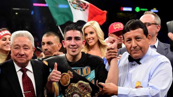 Leo Santa Cruz poses for a picture after a fifth round TKO of Kiko Martinez to retain the WBA Featherweight Super title at Honda Center on February 27, 2016 in Anaheim, California. (Photo by Harry How/Getty Images)