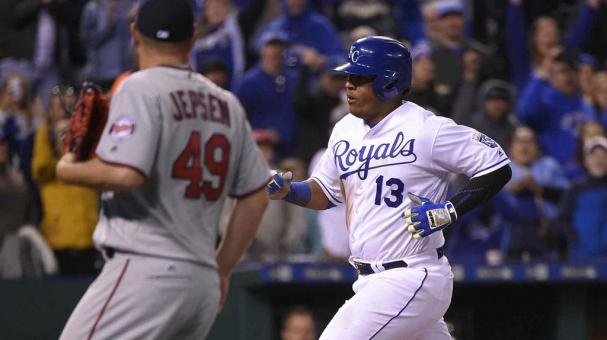 Salvador Perez #13 of the Kansas City Royals crosses home as he scores past Kevin Jepsen #49 of the Minnesota Twins in the eighth inning at Kauffman Stadium on April 8, 2016 in Kansas City, Missouri. (Photo by Ed Zurga/Getty Images)