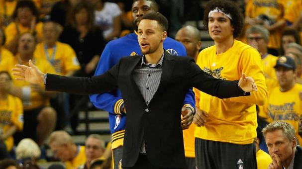 Injured point guard Stephen Curry #30 of the Golden State Warriors supports his team from the bench in Game Two of the Western Conference Quarterfinals during the 2016 NBA Playoffs at ORACLE Arena on April 18, 2016 in Oakland, California. Getty Images