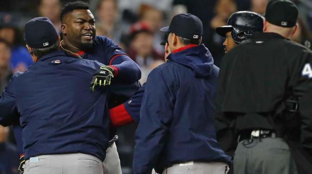 David Ortiz #34 of the Boston Red Sox is restrained by a coach after being thrown out of the game arguing a called strike by home plate umpire Ron Kulpa #46 in the ninth inning during a game at Yankee Stadium on May 6, 2016. (Getty Images)