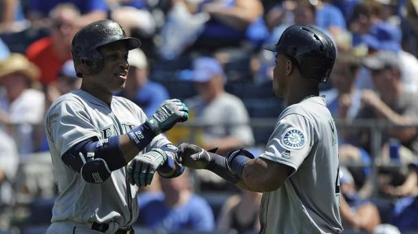 KANSAS CITY, MO - JULY 10: Robinson Cano #22 of the Seattle Mariners celebrates his two-run home run with Ketel Marte #4 of the Seattle Mariners in the seventh inning against the Kansas City Royals at Kauffman Stadium on July 10, 2016 in Kansas City, Miss