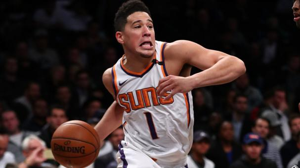 Devin Booker #1 of the Phoenix Suns drives against the Phoenix Suns during their game at Barclays Center on October 31, 2017 in the Brooklyn Borough of New York City. (Photo by Al Bello/Getty Images)