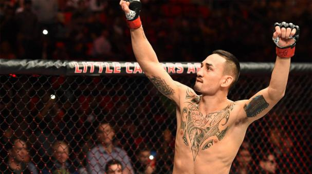 Max Holloway celebrates his victory over Jose Aldo