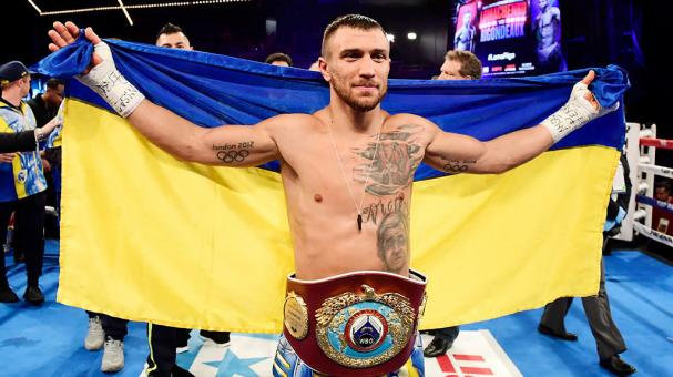 Vasiliy Lomachenko celebrates his Junior Lightweight bout victory over Guillermo Rigondeaux at Madison Square Garden on December 9, 2017 in New York City. (Getty Images)