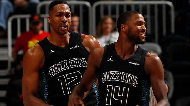 Dwight Howard #12 of the Charlotte Hornets reacts with Michael Kidd-Gilchrist #14 of the Atlanta Hawks at Philips Arena on January 31, 2018 in Atlanta, Georgia. (Getty Images)