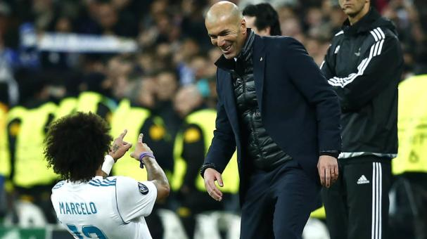 Marcelo of Real Madrid celebrates with Zinedine Zidane of Real Madrid during the UEFA Champions match between Real Madrid and Paris Saint-Germain at Bernabeu on February 14, 2018 in Madrid, Spain. (Getty Images)