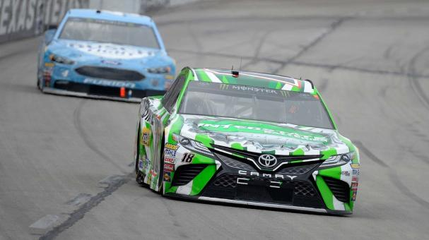 Kyle Busch, driver of the #18 Interstate Batteries Toyota, leads Kevin Harvick, driver of the #4 Busch Light Ford, during the Monster Energy NASCAR Cup Series O'Reilly Auto Parts 500 at Texas Motor Speedway on April 8, 2018 in Fort Worth, Texas. Getty