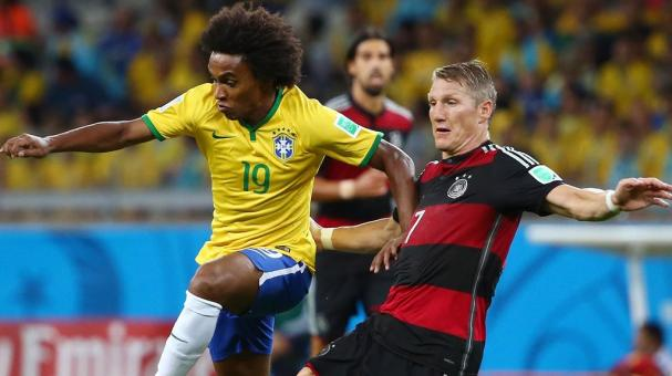 Willian of Brazil is challenged by Bastian Schweinsteiger of Germany during the 2014 FIFA World Cup Brazil Semi Final match between Brazil and Germany at Estadio Mineirao on July 8, 2014 in Belo Horizonte, Brazil. (Photo by Robert Cianflone/Getty Images)