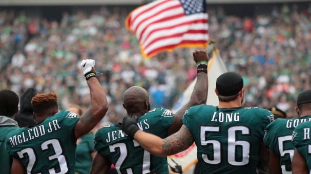 Rodney McLeod #23, Malcolm Jenkins #27 and Chris Long #56 of the Philadelphia Eagles stand during the National Anthem during the first quarter at Lincoln Financial Field on October 8, 2017 in Philadelphia, Pennsylvania. (Getty Images)