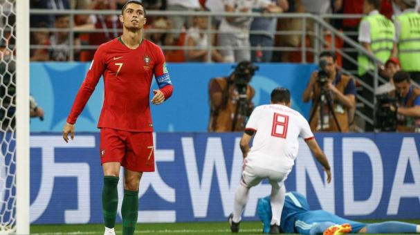 Cristiano Ronaldo of Portugal reacts after missing a penalty during the FIFA World Cup 2018 group B against Iran at Mordovia Arena Saransk, in Saransk, Russia, 25 June 2018. EFE