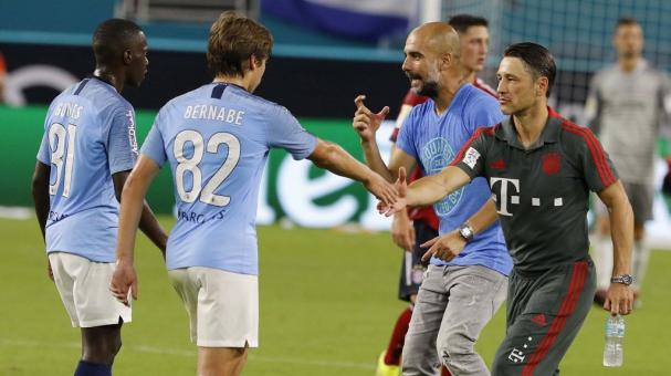Manchester City coach Josep Guardiola and Bayern Munich coach Niko Kovac (R) after their teams met in their International Champions Cup match at Hard Rock Stadium in Miami Gardens, Florida. EFE