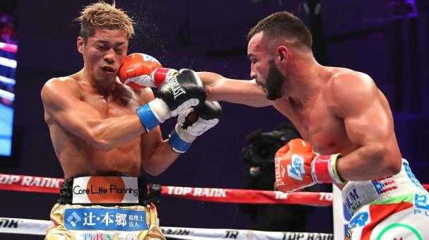 Christopher Diaz of Puerto Rico (R) and Masayuki Ito of Japan exchange punches during the WBO Super Featherweight title boxing match at the Kissimmee Civic Center on July 28, 2018 in Kissimmee, Florida. (Getty Images)