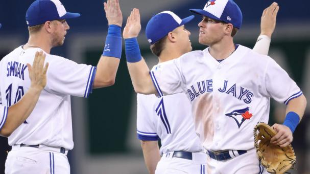 Billy McKinney #28 of the Toronto Blue Jays celebrates a victory with teammates against the Baltimore Orioles at Rogers Centre on August 21, 2018 in Toronto, Canada. (Getty Images)