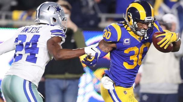 Los Angeles Rams running back Todd Gurley II (R) and Dallas Cowboys cornerback Chidobe Awuzie (L) at the NFC Divisional Round playoff NFL American Football game at the LA Memorial Coliseum in Los Angeles, California, USA, 12 January 2019. EFE
