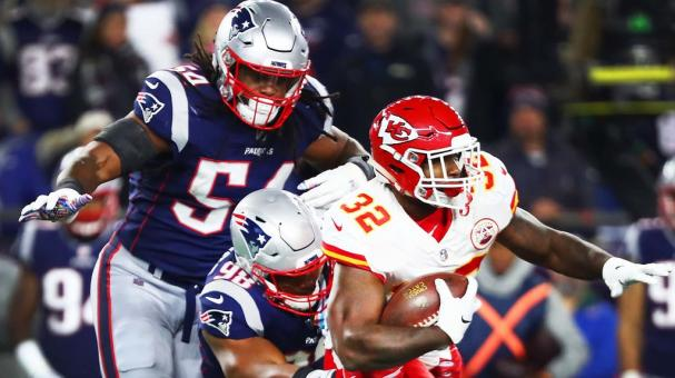 Spencer Ware #32 of the Kansas City Chiefs is tackled by Trey Flowers #98 of the New England Patriots at Gillette Stadium on October 14, 2018 in Foxborough, Massachusetts. (Getty Images)