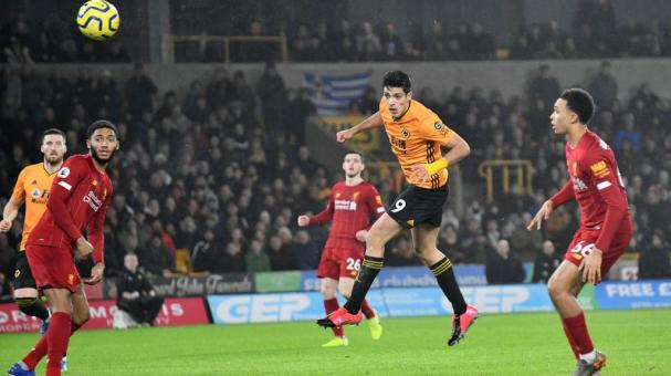 Raul Jimenez of Wolverhampton Wanderers scores a goal to make it 1-1 during the Premier League match between Wolverhampton Wanderers and Liverpool FC at Molineux on January 23, 2020 in Wolverhampton, United Kingdom. (Getty Images)