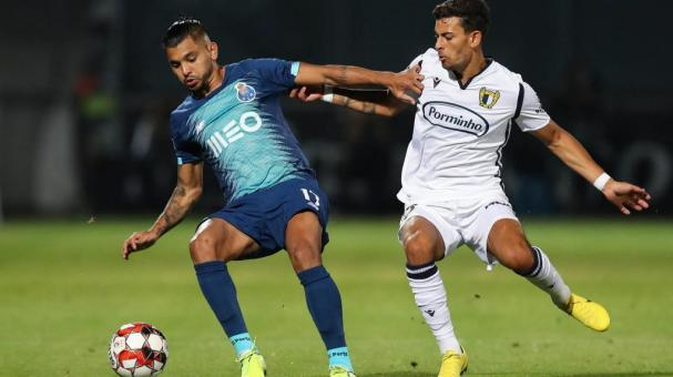 Famalicao`s Ruben Lameiras (R) in action against FC Porto's Tecatito Corona during their Portuguese First League soccer match, held at 22 June Municipal stadium, in Vila Nova de Famalicao, north of Portugal, 03 June 2020. EFE